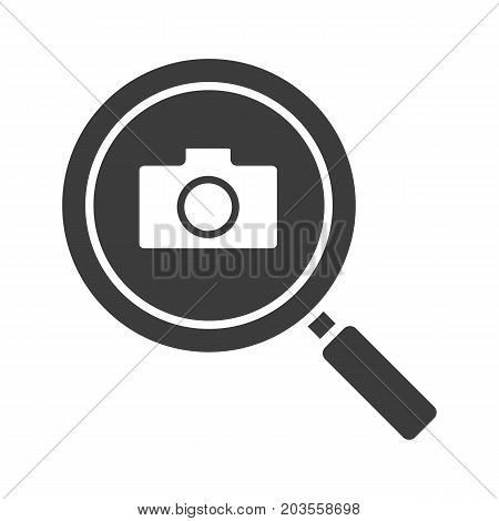 Image search glyph icon. Silhouette symbol. Magnifying glass with photocamera. Negative space. Vector isolated illustration