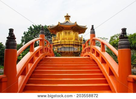 Golden pavilion and red bridge antique in chinese temple.