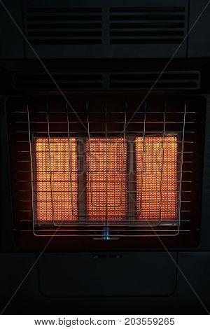 background gas furnace close-up burning gas, stove