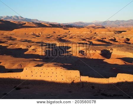 Desert and high ATLAS MOUNTAINS range landscape in central MOROCCO warm sunny winter day, northern Africa on February.