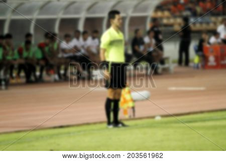 Blurry Assistant Football Referee And Referee's Flag