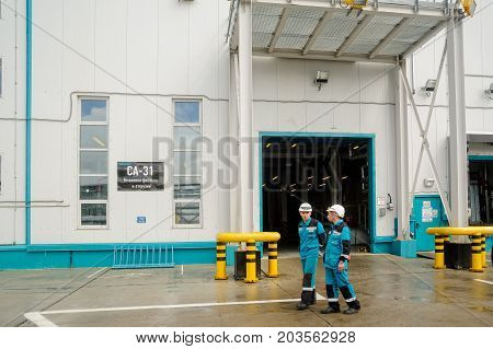 Tobolsk, Russia - July 15. 2016: Sibur company. Polymer plant. Gas-chemical complex on polypropylene production. Worker near SA-31 Installation of packing and shipment shop