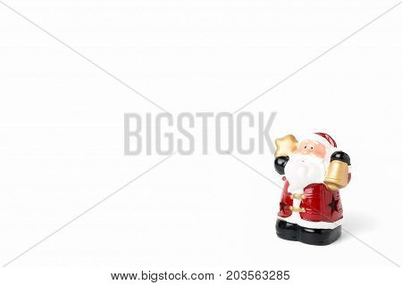 Figurines of Santa Claus on white background