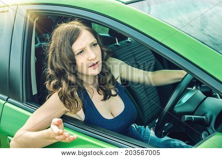Angry Woman Driver Screaming In The Car. Quarrel And Dissatisfaction On The Way.
