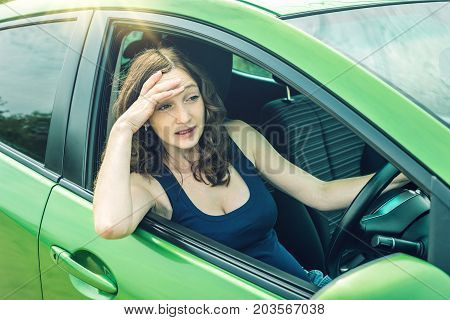 Angry And Frustrated Woman Driver In The Car. Quarrel And Dissatisfaction On The Way.