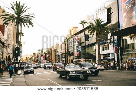 LOS ANGELES - OCTOBER 12 2015: View of Hollywood Boulevard at sunset. In 1958 the Hollywood Walk of Fame was created on this street as a tribute to artists working in the entertainment industry