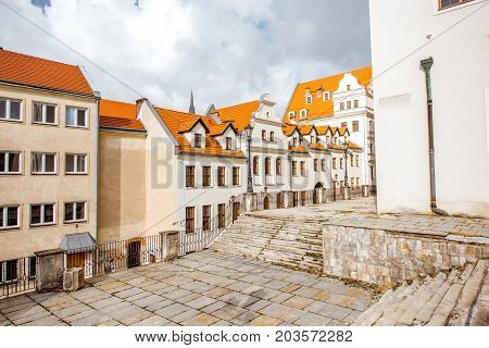 SZCZECIN, POLAND - August 13, 2017: Street view on the old houses and Ducal castle walls during the morning light in Szczecin city, Poland