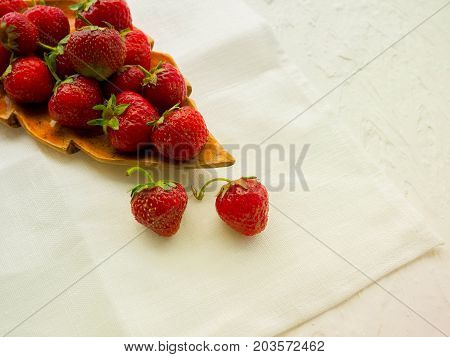 Strawberry. Fresh strawberry. Red strewberry. Strawberry Juice. Loosely laid strawberries in different positions.Fresh strawberries in a bowl on wooden table with low key scene.