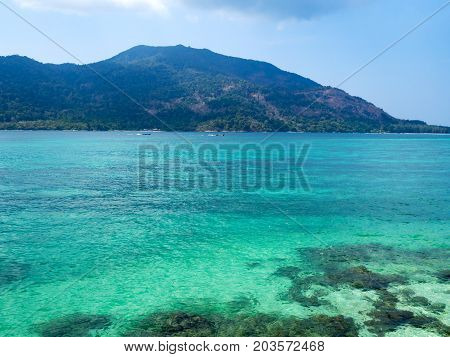 Crystal turquoise green sea ocean clear water and mountain at Lipe Island Satun Thailand.