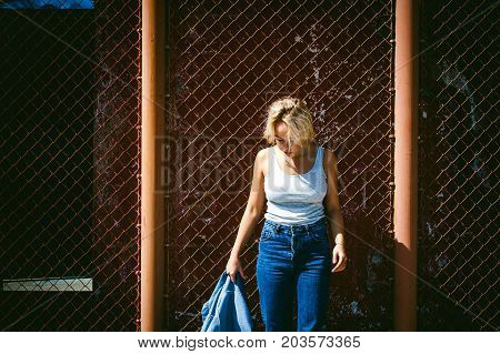 Young Woman In Jeans Clothes Outdoors. Portrait Of A Girl With Freckles On Her Face, Stylish Girl On
