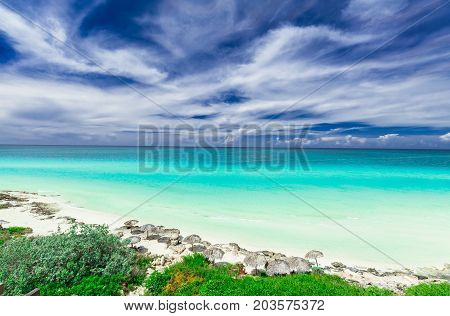 gorgeous amazing, beautiful, stunning view of tropical white sand beach and tranquil turquoise tender ocean on sunny summer day and blue magic deep, blue sky background at Santa Maria island,Cuba