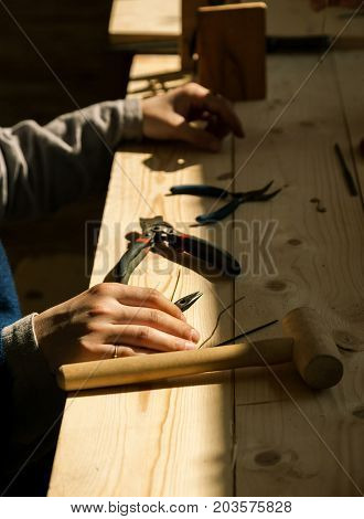 Female Craftsman Hands With Tools On A Wooden Table