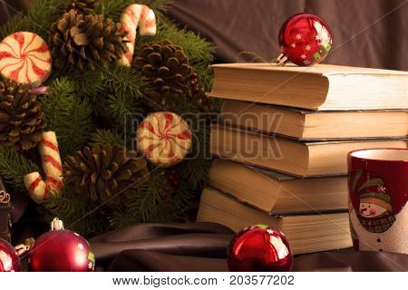 New Year's Composition From Mugs, Books, Caskets, Christmas Balls And A Spruce Wreath