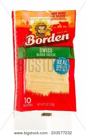 Winneconne WI - 7 September 2017: A package of Borden swiss sliced cheese on an isolated background.
