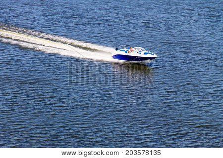 Kremenchug Ukraine - July 2 2017: Motor boat floating on the river Dnieper