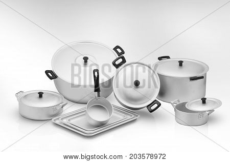 several cooking pots on a light background