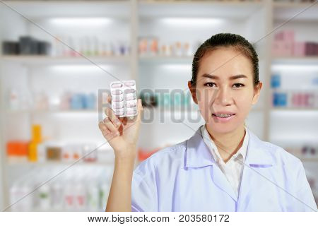 Pharmacist And Doctor Woman Holding Pill In Hand , Health Care And Pharmacology Concept On Medicine