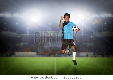Soccer Football Player Young Man Happiness Holding Ball Jump And Soccer Players Team Group Celebrati