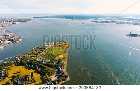 Aerial view of the Governors Island, New York with the Statue of Liberty in the background