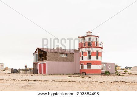 WLOTZKASBAKEN NAMIBIA - JUNE 29 2017: A house in Wlotzkasbaken a small holiday village in the Namib Desert between Henties Bay and Swakopmund on the Skeleton Coast of Namibia