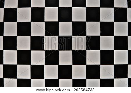 Black gray surface in a cage, like a chess board