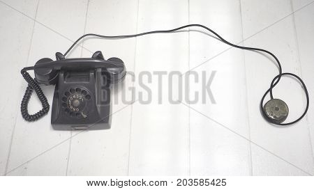 Background telephone antique black color and retro photo soft color Isolate on white wood floor has copy space.
