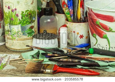 BRNO CZECH REPUBLIC -10 September 2017: Products made by decoupage technique. Decoupage is a technique of decorating items napkins. Workshop of the painter. Work desk mess
