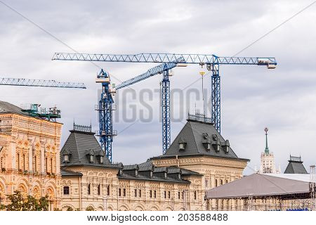 Crains on construction site of building. Construction background