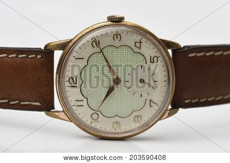 old automatic watch with green dial and white backround