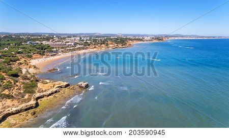 Aerial. Shores of the village Olhos de Agua are shot from sky by drones. Algarve