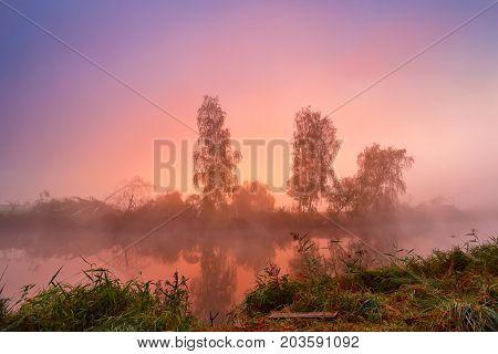 Autumn Colorful Sunrise On The Foggy Calm River. Autumn Misty Morning.
