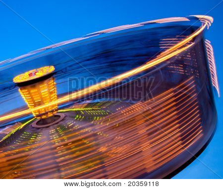 Abstract of spinning, tilting wheel at carnival. poster