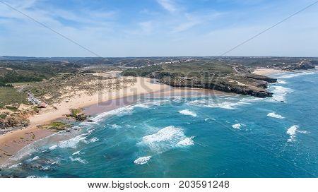 Aerial. Amoreira Beach is filmed from the sky. Aljezur, Portugal