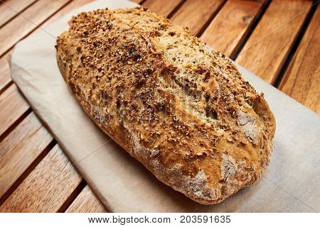 Loaf Of Homemade Bread Whit Coriander Seeds On Wooden Background, Food Closeup.