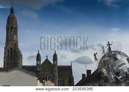 Saint-Laurent-sur-Sevre France - September 10 2016: The Basilica of St. Louis de Montfort and memorial fountain at Saint-Laurent-sur-Sèvre in the department of Vendée in the Pays de la Loire region in France