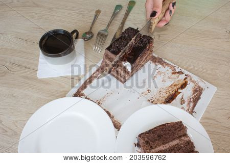 Coffee cup and chocolate cake onon wooden table. Coffee and a piece of cake.