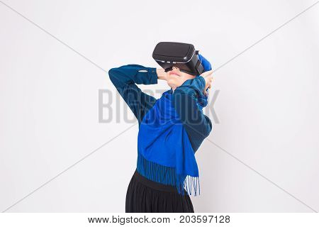 Young muslim woman with virtual reality glasses. Technology, vr, future and people concept.