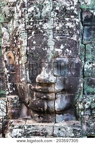 Stone smiling face King Jayavarman VII towersin Prasat Bayon Khmer temple constructed in the late 12th or early 13th century and located in the ancient city of Angkor today Cambodia.