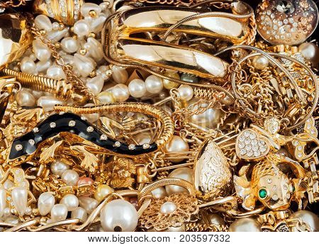 Expensive Gold Jewelry pearl necklace ring gold fish background
