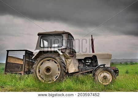 a tractor in the field, harvest time