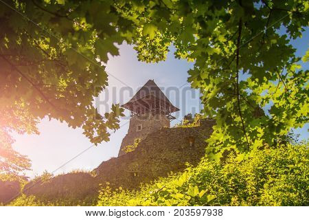 Protection and defense concept. Bastion on sunny summer day. Castle tower and wall. Landmark and travel destination. Stone fortification on green hill on blue sky.