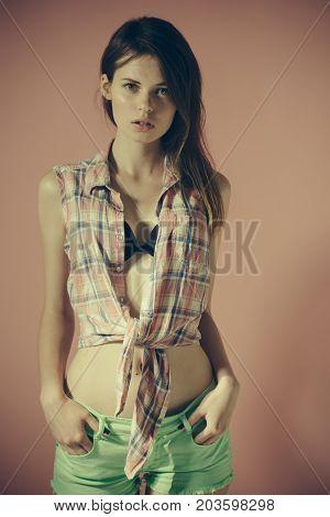 Girl Posing On Pink Background