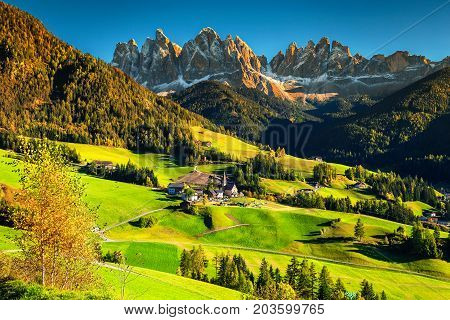 Fabulous best alpine place of the world Santa Maddalena village with magical Dolomites mountains in background Val di Funes valley Trentino Alto Adige region Italy Europe