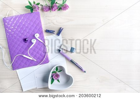 Mockup for the girl, women, a set of objects in lilac, tones. Diary, pen, headphones, saucer-heart, flowers clover. Dreams of a girl in love. Diary of love. Dreams of a new life.  space for text