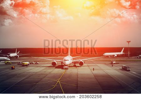 Aircraft or airplanes on the aerodrome landing site, toned, solar filter