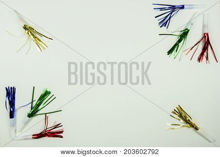 Colorful Party Noise Makers Border On White