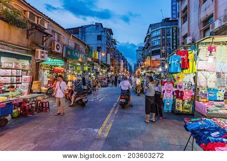 TAIPEI TAIWAN - JULY 01: This is a small local night market which many Taiwanese people come to buy cheap items on July 01 2017 in Taipei