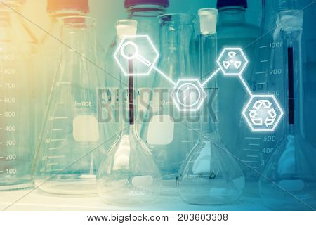 Laboratory Research - Scientific Glassware or beakers with Science icons For Chemical Background concept.