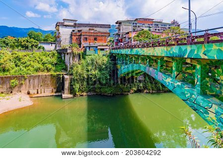 TAIPEI TAIWAN - JUNE 29: This is a bridge and riverside architecture in the historic rural district of Shenkeng on June 29 2017 in Taipei