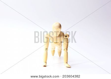 Wooden figure doll with push up emotion for sport exercise concept on white background.